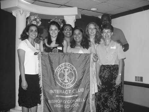 The New Interact Club of Bishop O'Connell High School received its charter from Rotary International at the June 7 meeting of the Falls Church Rotary Club at the Harvest Moon Restaurant. From left to right: Lauren Cruz, Secretary, Meredith Loken, Vice President, Camille Richards, President, Anna Castillo, graduating President,  and Casey Philbin, Tresurer, with faculty sponsor, Peggy Lane, right front and Falls Church Rotary sponsor, Earl Brown, right rear. (Photo: Courtesy Joseph Scheibeler)
