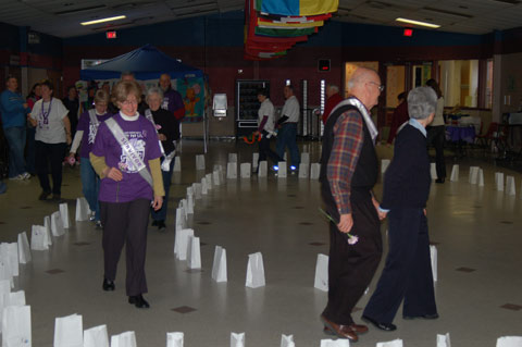 AT A KICK-OFF EVENT to organize for the annual Relay For Life rally in Falls Church in May was held at George Mason High School Saturday. The American Cancer Society sponsored Relay For Life rallies all across the U.S. to inspire hope and raise money for cancer research. Here, some cancer survivors and their loved ones walked a symbolic relay as others watched. The May 31 event will be held at the GMHS football field, starting at dusk and going all night with teams organized to carry on a relay race the entire time. (News-Press photo)