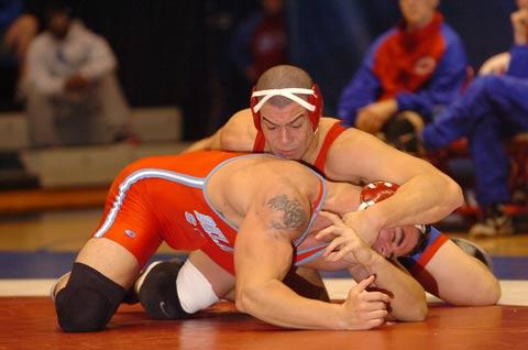 JOSH GLENN (TOP) hopes his individual success can lift the prestige of American University's wrestling program. (Photo: Courtesy American University)