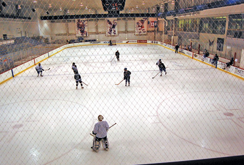A YOUTH HOCKEY TEAM SKATES at Kettler Capitals Iceplex. School and community teams have clamored to use the newly opened rink, the first inside the Virginia half of the Beltway. (Photo: News-Press)