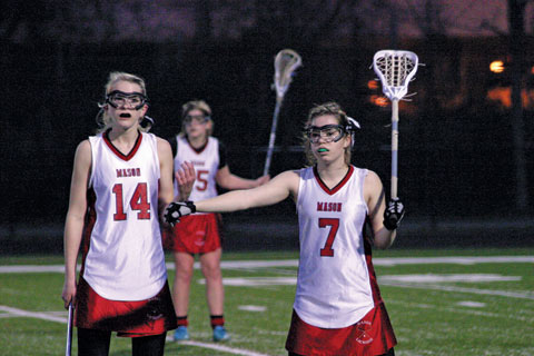 KATRINA SNYDER AND GRACE KUIPERS position themselves in the late stages of the first half of Monday's game against Dominion. (Photo: News-Press)