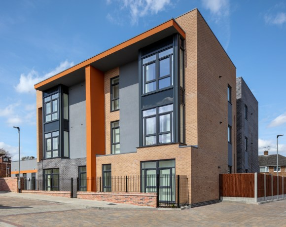 Contractor J Tomlinson has completed a £2 million project to replace a former sheltered housing scheme with 12 new apartments and six new houses for affordable rent.