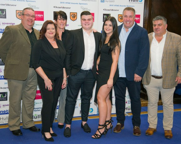 Lewis apprentice, centre, pictured with family and TLJ employees at HTAE Awards