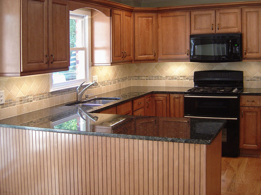 remodeled traditional kitchen rich maple cabinets black granite appliances