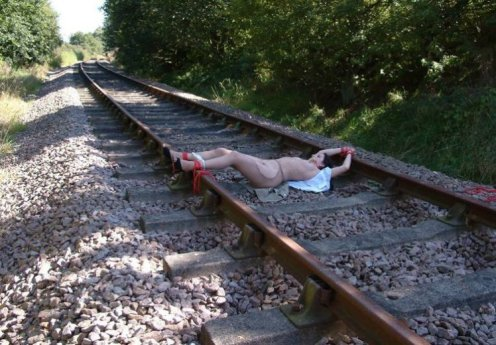 Beautiful Brunette Gets Stripped and Tied to Tracks