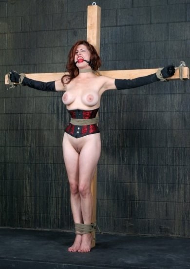 Beautiful Redhead in Corset Gets Gagged and Crucified