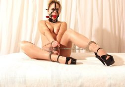 Hot Model in Tights Cuffed and Gagged in High Heels