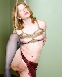Madison Young Bound and Spread in Stockings and Heels