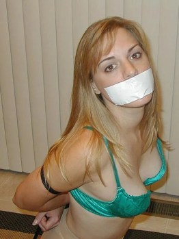 Girlfriend in Stockings and Sexy Lingerie Bound and Tape Gagged for Fun