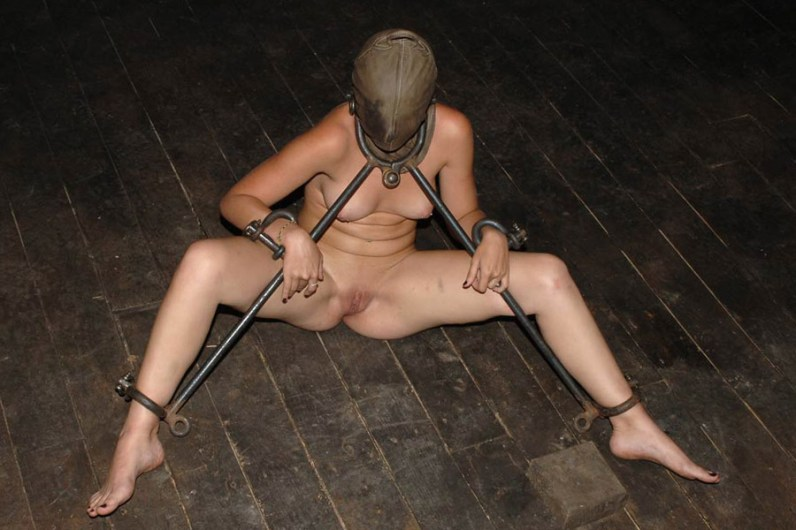 Kinky Young Model Collared, Restrained and Hooded in Dungeon for Fun