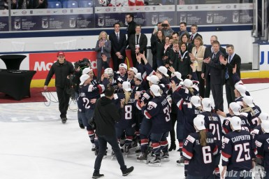 Team USA lifts the IIHF Women's World Championships cup.
