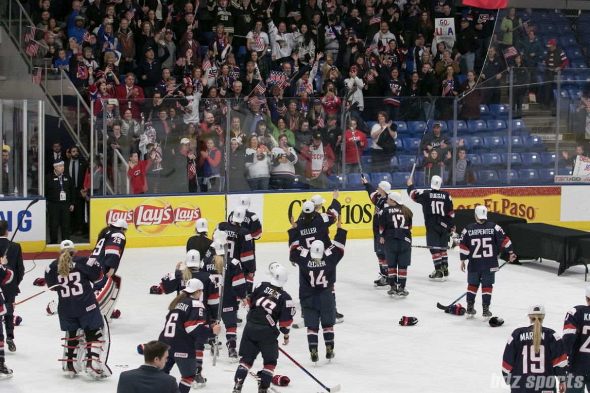 Team USA skates over to the USA family and friends section after being awarded the gold medal.
