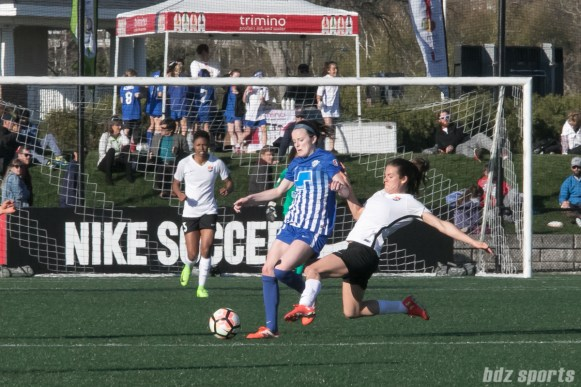 Breakers' Rose Lavelle #11 controls the ball at midfield with Sky Blue FC's Kelly O'Hara #19 sliding in.