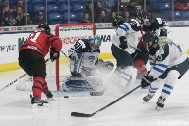 Finland's Noora Ray #41 makes a stop against on oncoming team Canada.
