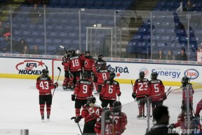 Canada celebrates with team Canada goalie Shannon Szabados #1 who made 23 saves for the shutout.