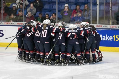 Team USA huddles before the start of their IIHF Women's World Championship game against Germany.