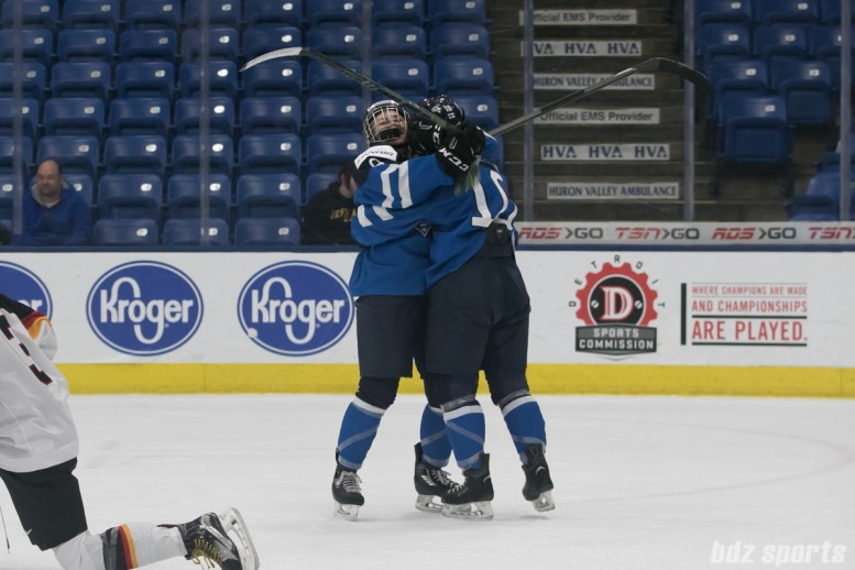 Finland's Venla Hovi #9 celebrates with teammate Linda Valimaki #10 after Hovi scores off an assist from Valimaki.