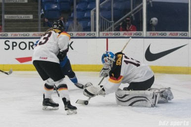 Germany's Ivonne Schroder #13 makes a stop against Finland.