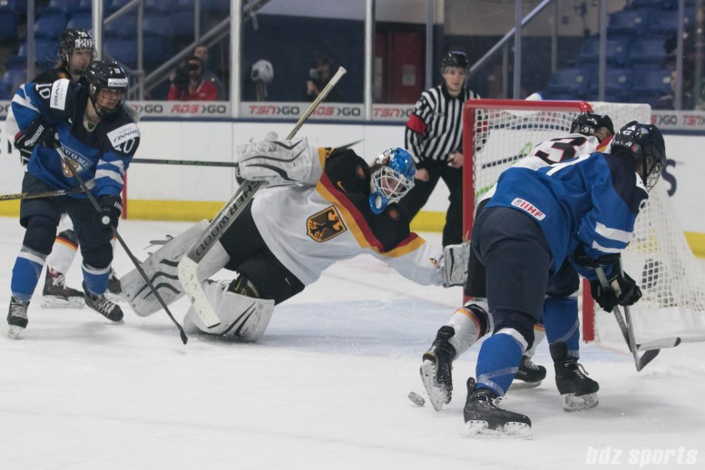 Germany's Ivonne Schroder #13 dives to cover the goal on a loose puck.