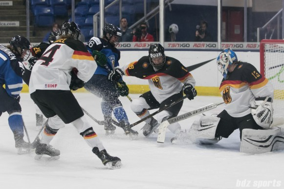 Germany's Bernadette Karpf #18 and Ivonne Schroder #13 keep the puck out of the goal.