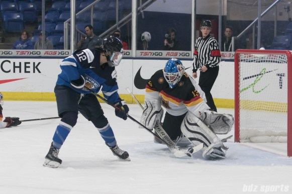 Germany's Ivonne Schroder #13 stops Finland's Susanna Tapani #12 on the breakaway.