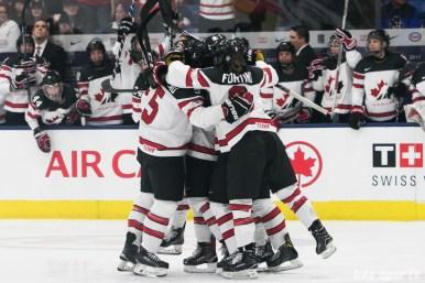 Team Canada celebrates Meghan Agosta #2's goal one minute into the game to put Canada up 1-0.