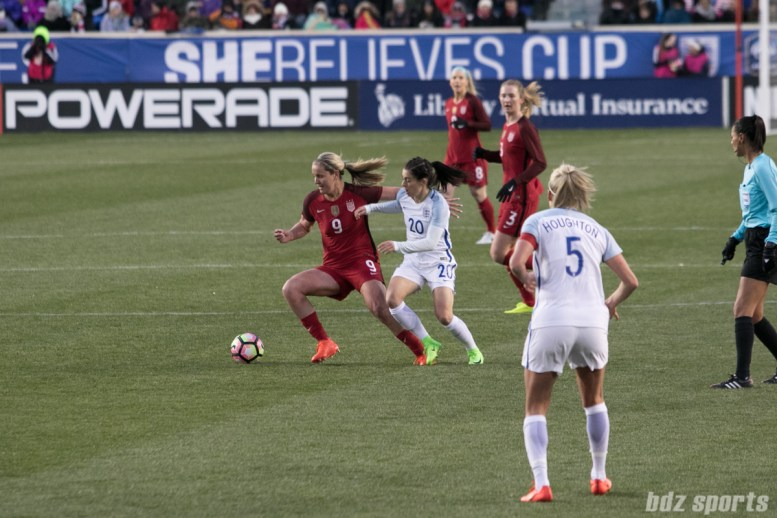 Team USA Lindsay Horan fends off a defender