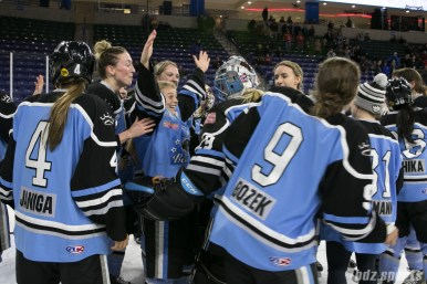 Beauts Emily Pfalzer celebrates with goalie Brianne McLaughlin