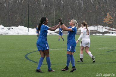 Breakers Ifeoma Onumonu high fives Adriana Leon