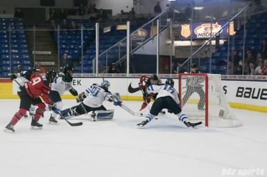 Canada's Sarah Potomak #44 scores the game's first goal