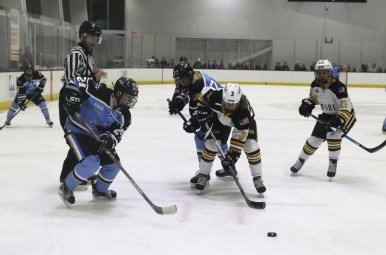 Buffalo Beauts Harrison Browne and Boston Pride Jillian Dempsey face off