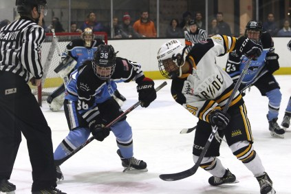 Buffalo Beauts Kourtney Kunichika and Boston Pride Rachel Llanes face off