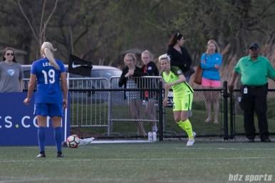 Reign FC's Megan Rapinoe #15 takes a corner kick.