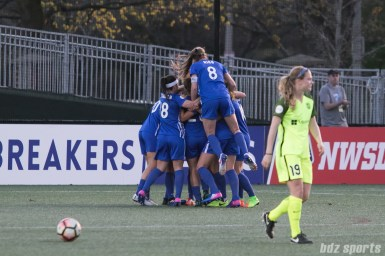 Breakers' Julie King #8 jumps on the Breakers celebration after Rose Lavelle scored her first NWSL goal.