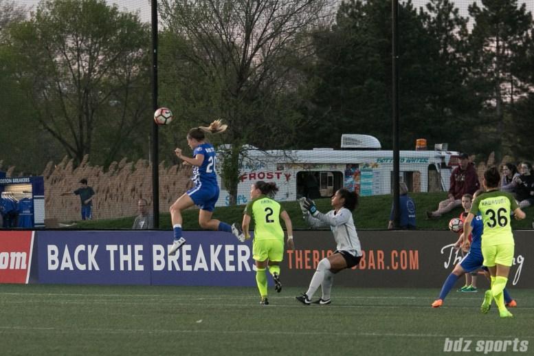 Breaker's Christen Westphal #20 heads the ball out of danger.