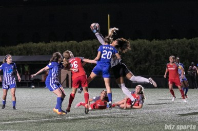 Boston Breakers goalkeeper Abby Smith (14) grabs the ball out of danger.