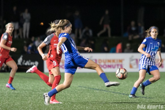 Boston Breakers defender Christen Westphal (20) volleys the ball away.