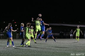 Reign FC's Jess Fishlock #10 challenges Breakers' Megan Oyster #4 for the ball.