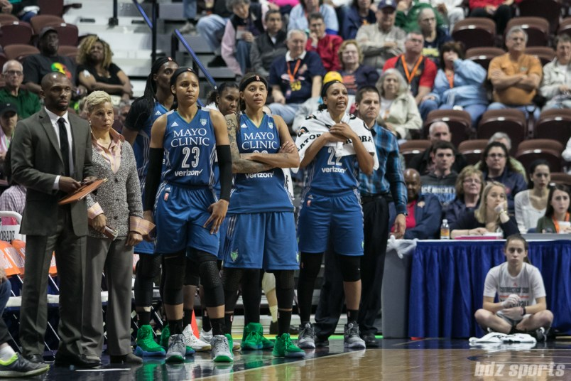 Minnesota Lynx Maya Moore (23), Seimone Augustus (33), and Plenette Pierson (22) look on from the bench.