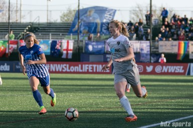 Courage's Sam Mewis #5 brings the ball down field.