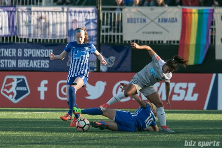 Breakers' Rosie White #10 slide tackles the ball to teammate Rose Lavelle #11.