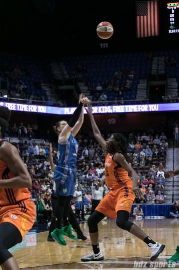 Minnesota Lynx guard Lindsay Whalen (13) attempts a 3-point shot over Connecticut Sun center Jonquel Jones (35).