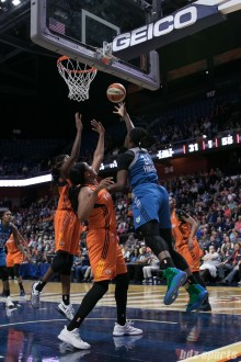 Minnesota Lynx center Sylvia Fowles (34) goes baseline for the reverse lay-in.