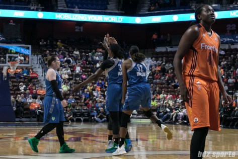 Minnesota Lynx forward Rebekkah Brunson (32) and team react to Minnesota Lynx center Sylvia Fowles (34) making the shot while being fouled.