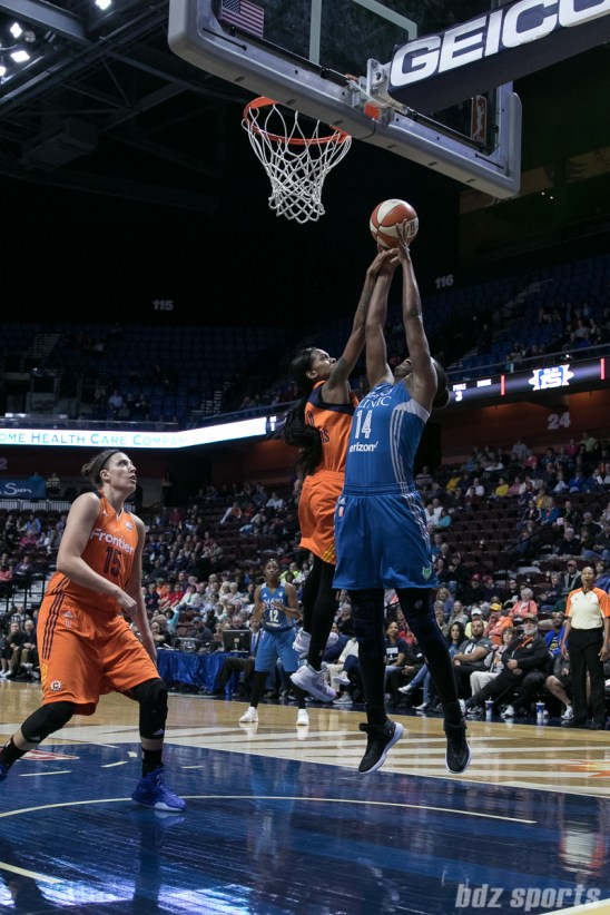 Connecticut Sun guard Courtney Williams (10) goes up to block Minnesota Lynx center Temi Fagbenle (14).