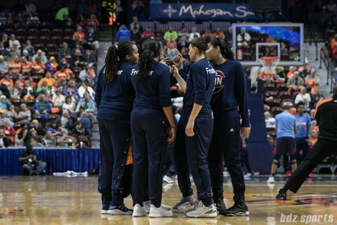 The Connecticut Sun huddle before the start of the game.