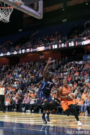 Sun's Morgan Tuck #33 drives baseline against the Atlanta Dream's Elizabeth Williams #1.
