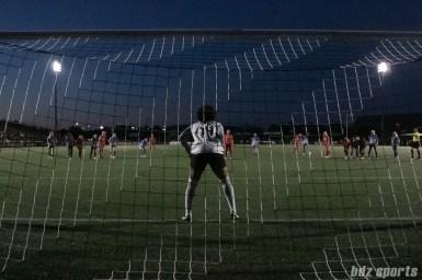 Boston Breakers goalkeeper Abby Smith (14) faces Portland Thorns FC forward Nadia Nadim (9) on a penalty kick.