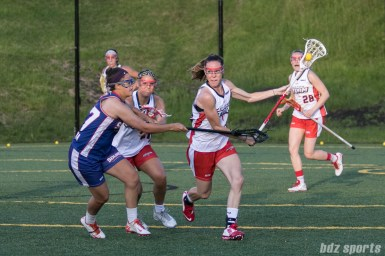 Boston Storm midfielder Abby Rehfuss (15) takes the ball upfield while being challenged by Long Island Sound attacker Halle Majorana (37).