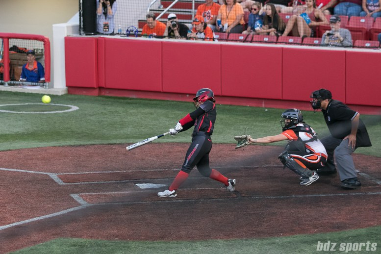 Akron Racers outfielder Taylor Schlopy (2) hits the ball out of the park for a two-run homerun.